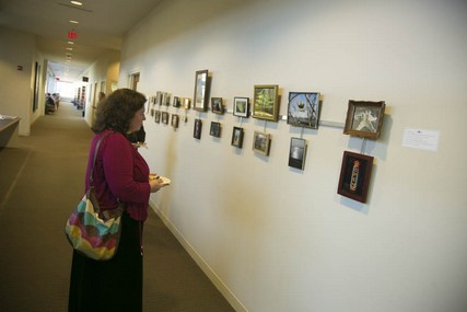 In the exhibit, photos from the same day are displayed together.