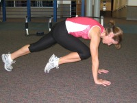 Plank with knees to chest exercise