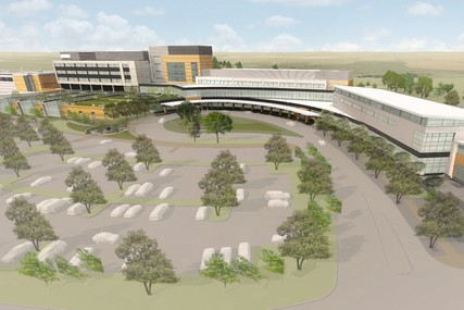 UW Health at The American Center will be a 494,000 square foot facility offering inpatient and outpatient care as well as a strong program of wellness and preventive care. At left in the foreground is the facility's universal care center, housing both emergency services and outpatient procedural areas. Behind the UCC, is the inpatient hospital with 56 private patient rooms. Outpatient clinics are located in the central wing of the building. At right in the east wing is the wellness, fitness and sports performance area with therapeutic pools, classrooms and a demonstration kitchen.