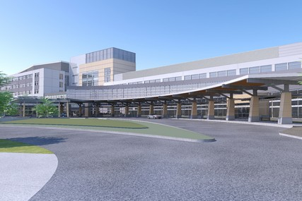 At ground level, a sweeping driveway and canopy bring patients and visitors directly to the main and clinics entrances.