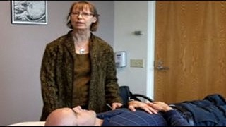 Integrative Medicine acupuncturist Colleen Lewis gives an acupuncture demonstration