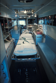 Inside the Critical Care Transport Unit, a critical care nurse and physician provided care en route while Madison Fire Department paramedics drove the bus. The patient was on a bed secured to the floor, and the staff often stood bedside, which required extraordinary balancing skills, especially when the bus rounded a corner.