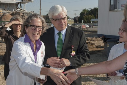 UW Health's Dr. Laurel Rice, chair of the Department of Obstetrics and Gynecology, and St. Mary's Hospital president Dr. Frank Byrne, greet guests at the groundbreaking ceremony.