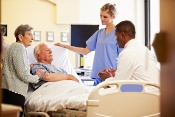 Older couple in hospital room with nurse and doctor