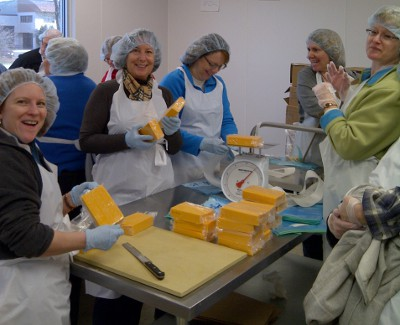 UW Hospital and Clinics clinic operations leaders processed 6,000 pounds of cheese at Second Harvest Foodbank on Nov. 17