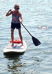Betsy, standup paddleboarding after her total knee replacement.