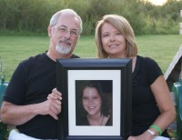 The Pasewald's with a photo of their daughter, Christina