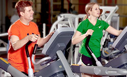 UW Health Sports Medicine Fitness Center/Classes: Instructor helping student lifting weights