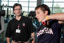 UW Health Sports Medicine Fitness Center's Jude Sullivan working with athlete