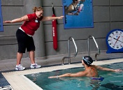 UW Health Sports Medicine services: instructor teaching swimmer