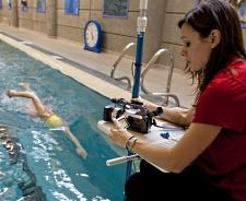 UW Health Aquatic Center swim stroke filming: Instructor filming a swimmer