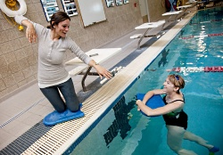 UW Health Sports Medicine Fitness Center swim instructor and student in pool