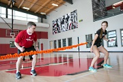 UW Health Sports Rehabilitation Optimize physical therapy: Trainer working with young athlete