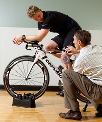 Biker and instructor in UW Health Sports Medicine's cycling clinic