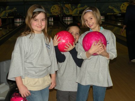 Three children with bowling balls
