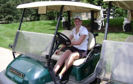 Teenage girl in golf cart