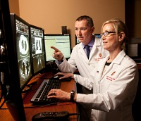 Spotlight on UW Health radiology: Two radiologists looking at a computer