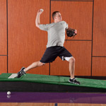 Baseball pitcher throwing off the indoor mound at UW Health Sports Rehabilitation