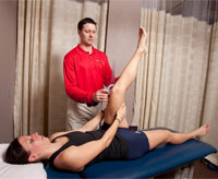 A physical therapist measures hamstring flexibility