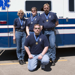 EMS personnel showing their medals; EMS Olympics