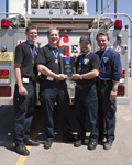 EMS personnel showing their award; EMS Olympics