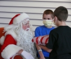 Santa at American Family Children's Hospital with twin brothers who were patients
