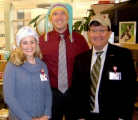 American Family Children's Hospital employees donning caps