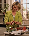 woman cooking; Go Red For Women Heart-Healthy Recipes