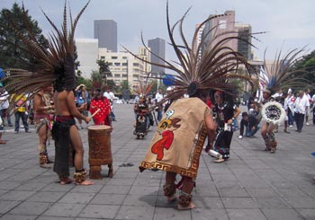 Indigenous dancers at the Universal Access March