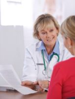 Doctor and patient; Genetic information helps doctors determine best dose