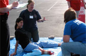 An EMS provider honed her emergency techniques for dealing with an amputee from a mock car accident; 2008 EMS Olympics