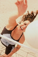 Woman hitting the heck out of a volleyball