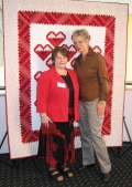 Helen Martin and Nancy Zeiman at the 2008 Quilt Expo with a Go Red for Women quilt