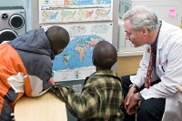 Two boys visiting from Kenya with Dr. James Conway             at American Family Children's Hospital