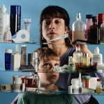 Mother and son looking in medicine cabinet