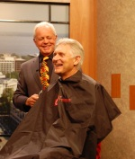 Bill Kaminiski gets ready to shave Andy North's head in preparation for the Cost Cutters Clip Cancer Fund Raiser