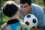 Soccer coach and boy