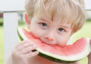 boy eating watermelon; UW Health Registered Dietitian Amy Podmolik offers advice for parents of picky eaters