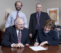 officials signing the documents; Watertown Area Health Services and UW Health Finalize Partnership