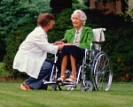 Woman in wheelchair and her doctor