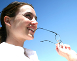 woman taking off glasses; UW Health Laser Refractive Eye Surgery, Madison, Wisconsin