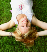 woman lying on the grass, face lift