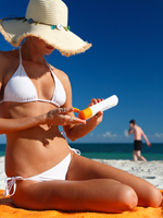 woman applying sunscreen; June Jeune Skin Care Special Offer - 20% off any sunscreen; UW Health Transformations, Madison, Wisconsin