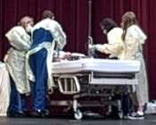 UW Health emergency medicine staff turn the Middleton Performing Arts Center into a mock emergency room.