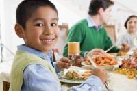 Boy Eating Dinner; Family meals are an important way to keep kids healthy