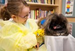 Rylee with Elvis, one of the Pet Pals therapy dogs