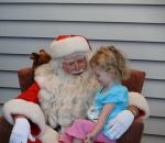 Santa visiting with a patient at American Family Children's Hospital