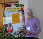 Donna Weihofen with samples of her chocolate covered blueberries