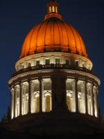 Wisconsin's State Capitol Building lit with orange lights