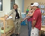 Couple with child learning about crib safety